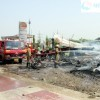 Fire fighters try to control fire at Furniture market at Sarai Kaale Khan, Delhi