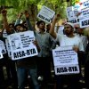 AISA protests saying stop targeting Muslim youth in the name of terrorism