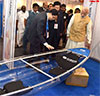 PM Modi going around an exhibition at the Maritime India Summit