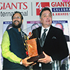 Prakash Javadekar presenting the Giants Award to Rishi Kapoor for films field