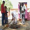PM Modi doing shramdan for the construction of a twin pit toilet